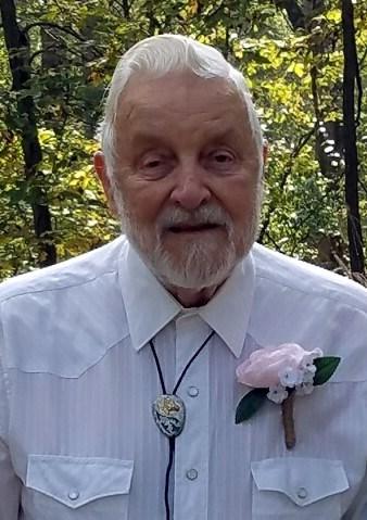 Raymond E.  Schultz